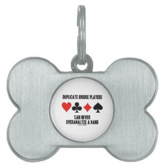 Los jugadores de puente duplicados pueden nunca placa de nombre de mascota