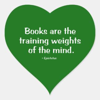 Los libros son los pesos de entrenamiento de la pegatina en forma de corazón
