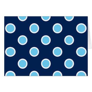 Los lunares del azul de cielo en la marina de tarjeta de felicitación