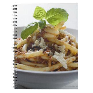 Los macarrones con pican la salsa y el queso libro de apuntes con espiral
