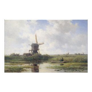 Los molinoes de viento holandeses acercan al río cojinete