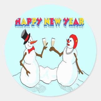 Los muñecos de nieve del Año Nuevo Pegatina Redonda
