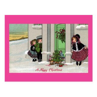Los niños emocionados aguardan sorpresa de Navidad Postales