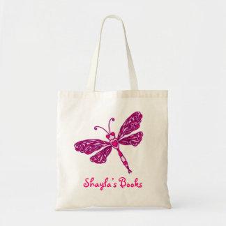 Los niños rosados de la libélula nombraron la bolsas de mano