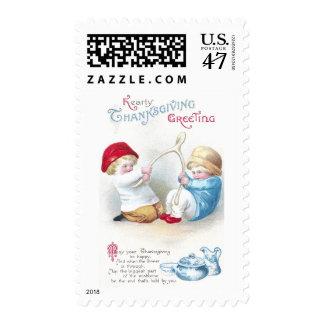 Los niños tiran en acción de gracias gigante del sellos postales