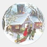 Los niños traen a casa navidad del vintage del etiquetas redondas