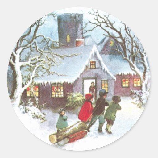 Los niños traen a casa navidad del vintage del pegatina redonda