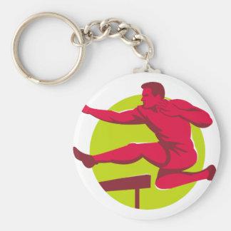 Los obstáculos de salto del atleta llavero redondo tipo pin