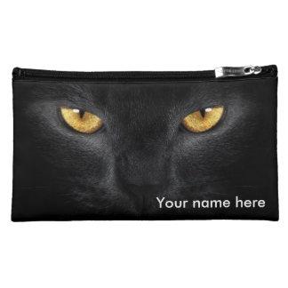 Los ojos de gato componen el bolso