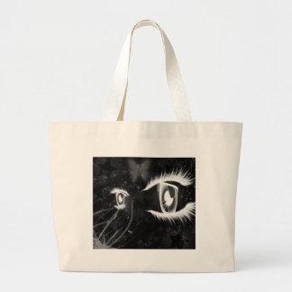Los ojos de gato frescos - ennegrézcase con los la bolsas de mano