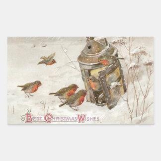 Los pájaros encuentran el refugio en navidad del pegatina rectangular