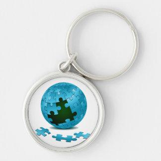 los pedazos azules del globo del rompecabezas caen llaveros