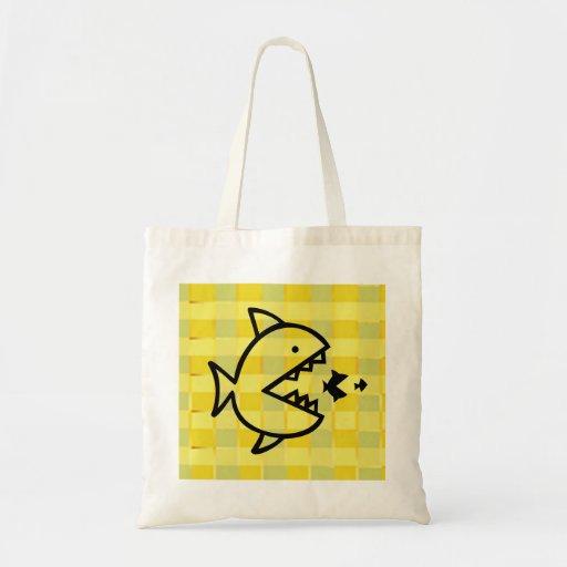 Los pequeños pescados de los pescados grandes - co bolsas