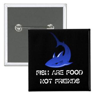 Los pescados son botón de la comida pins
