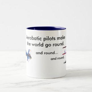 Los pilotos aeroacrobacias hacen que el mundo va taza de dos tonos