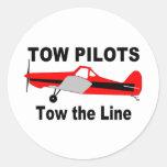 Los pilotos de la remolque remolcan la línea pegatina redonda