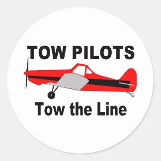 Los pilotos de la remolque remolcan la línea pegatinas redondas
