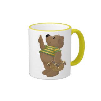 Los pulgares para arriba llevan taza de café