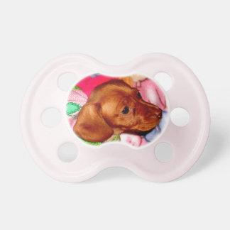 Los regalos del bebé del Dachshund o AÑADEN su fot Chupete