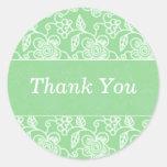 Los remolinos florales verdes le agradecen los peg