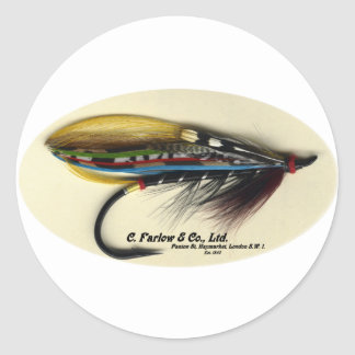 Los salmones vuelan el ala negra de la pluma del pegatina redonda