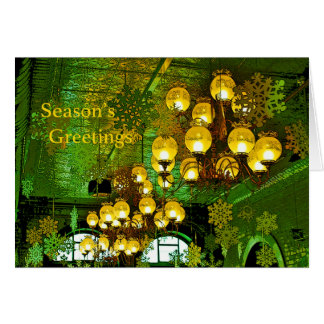 Los saludos verdes de la estación de los copos de tarjeta de felicitación