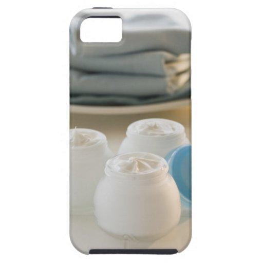 Los tarros de hidratación baten y pila de toallas iPhone 5 carcasas