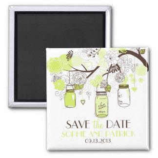 Los tarros y las flores verdes de albañil ahorran imán cuadrado