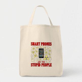Los teléfonos elegantes están para la gente bolsas lienzo