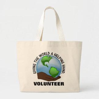 Los voluntarios son las manos amigas del mundo bolsa de mano