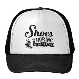 Los zapatos de los patines del hockey del desgaste gorro