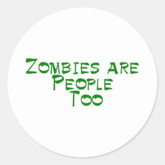 Los zombis son gente también pegatina redonda