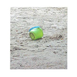 Lost Green Bucket in Sand on Summer Beach Notepad