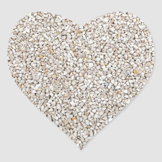 Lot of grey gravel stones as background heart sticker
