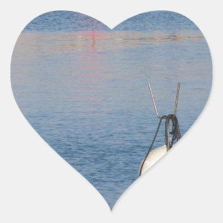 Lots of mooring buoys floating on calm sea water heart sticker