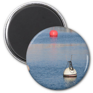 Lots of mooring buoys floating on calm sea water magnet
