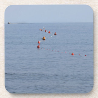 Lots of mooring buoys floating on water in marina beverage coaster