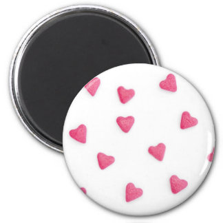 lots of pink candy hearts background magnet