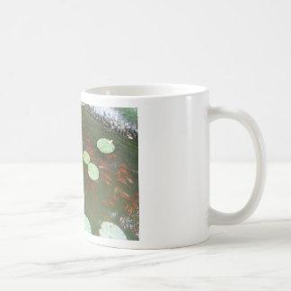 lotus flower fishes coffee mug
