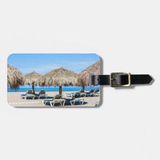 Lounge Chairs And Thatch Umbrellas On Beach Luggage Tag