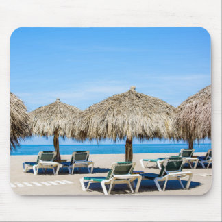 Lounge Chairs And Thatch Umbrellas On Beach Mouse Pad