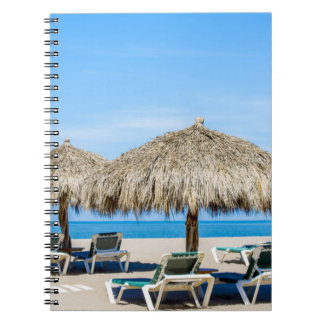 Lounge Chairs And Thatch Umbrellas On Beach Notebook