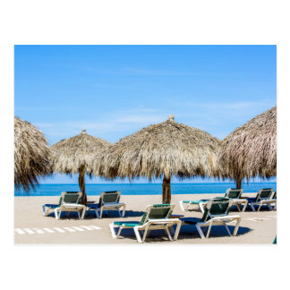Lounge Chairs And Thatch Umbrellas On Beach Postcard