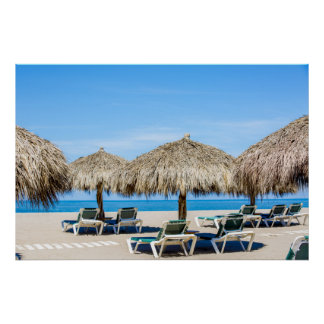 Lounge Chairs And Thatch Umbrellas On Beach Poster