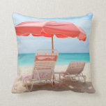 Lounge chairs on the ocean beach pillow
