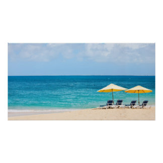 Lounge chairs on the ocean beach poster