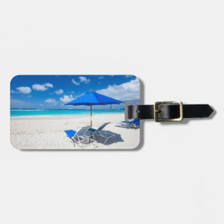 Lounges on the ocean beach bag tag