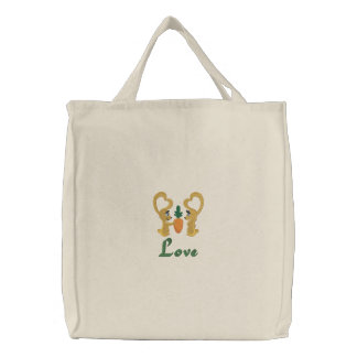 Love and Romance Easter Bunnies Share a Carrot Embroidered Tote Bag