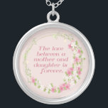 """Love Between a Mother and Daughter Necklace<br><div class=""""desc"""">The love between a mother and a daughter is forever.  Set in a circle of flowers on a pale pink background.</div>"""