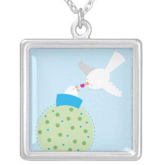 love birds giving custom jewelry